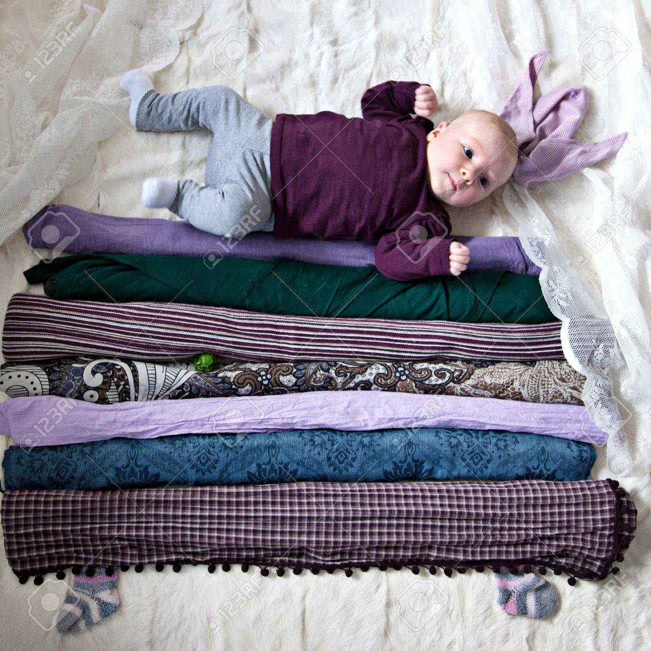 stack of mattresses. 4 Month Old Baby Girl On Stack Of Mattresses With Single Green Pea Stock Photo - L