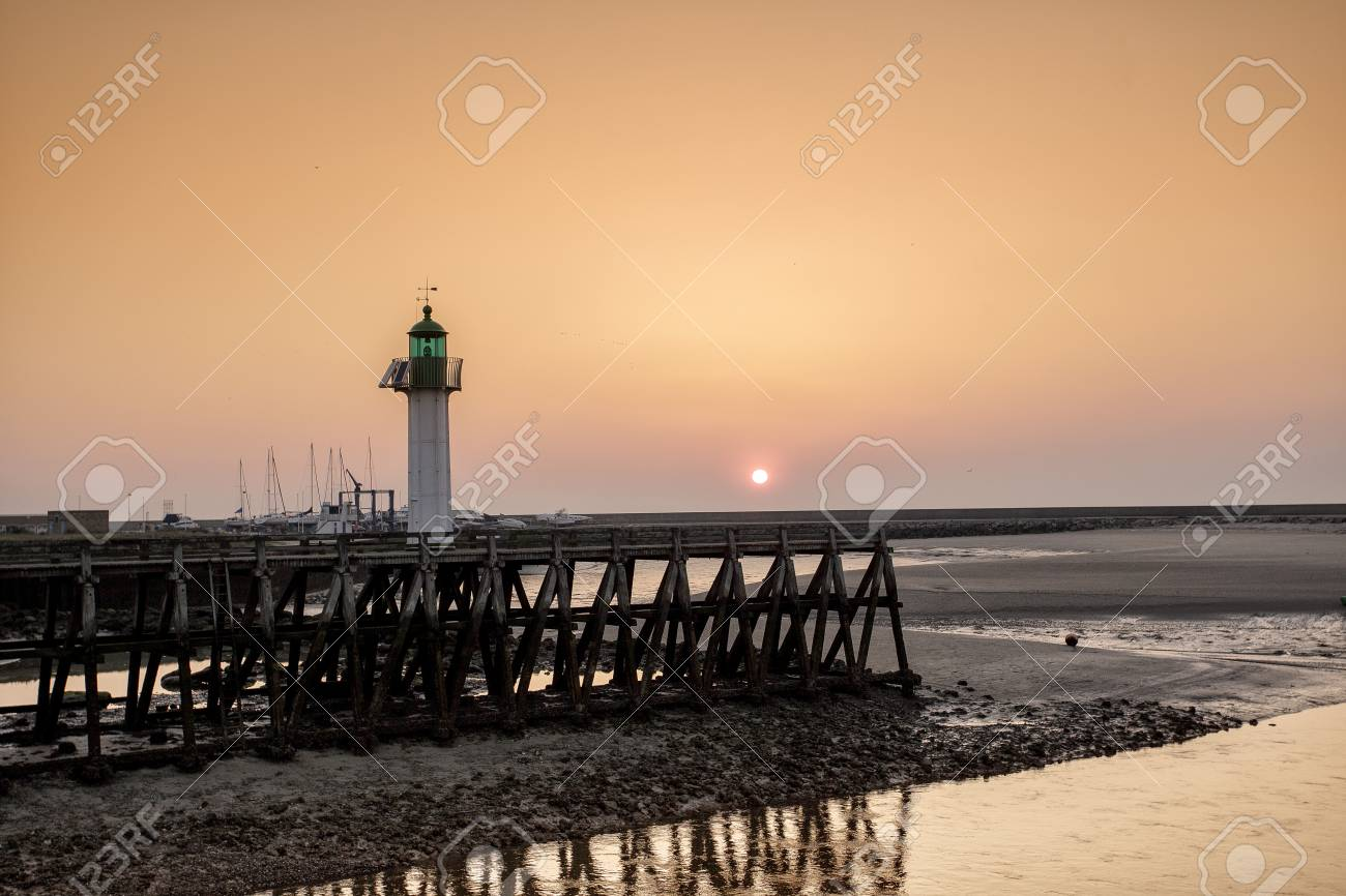 Mood Bilder sunset and evening mood at the of deauville with pier and