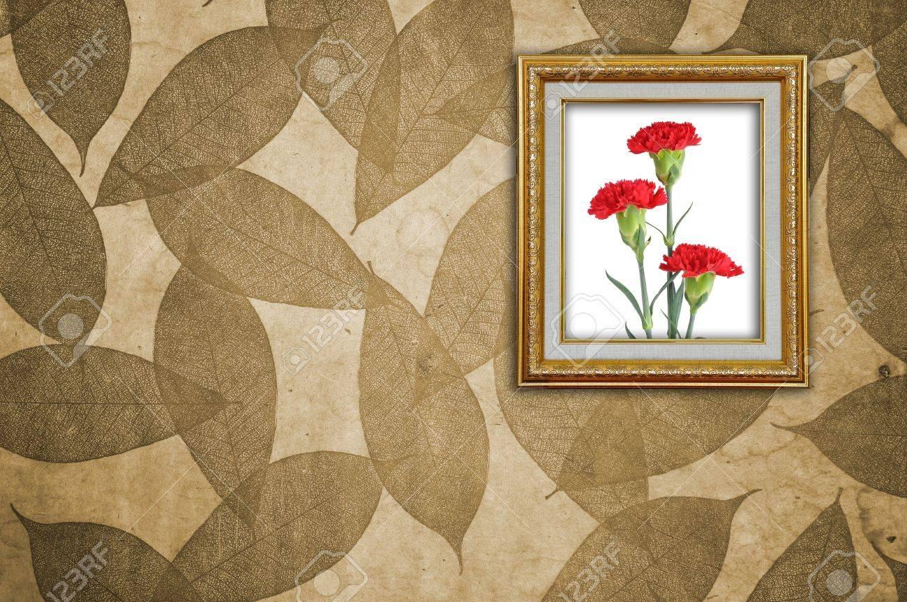 Carnation in Golden Frame on Leaves Pattern wallpaper Stock Photo - 8402056
