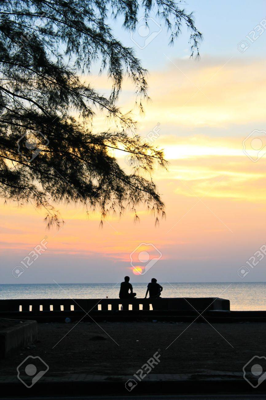 Two man looking to the sea Stock Photo - 12464378