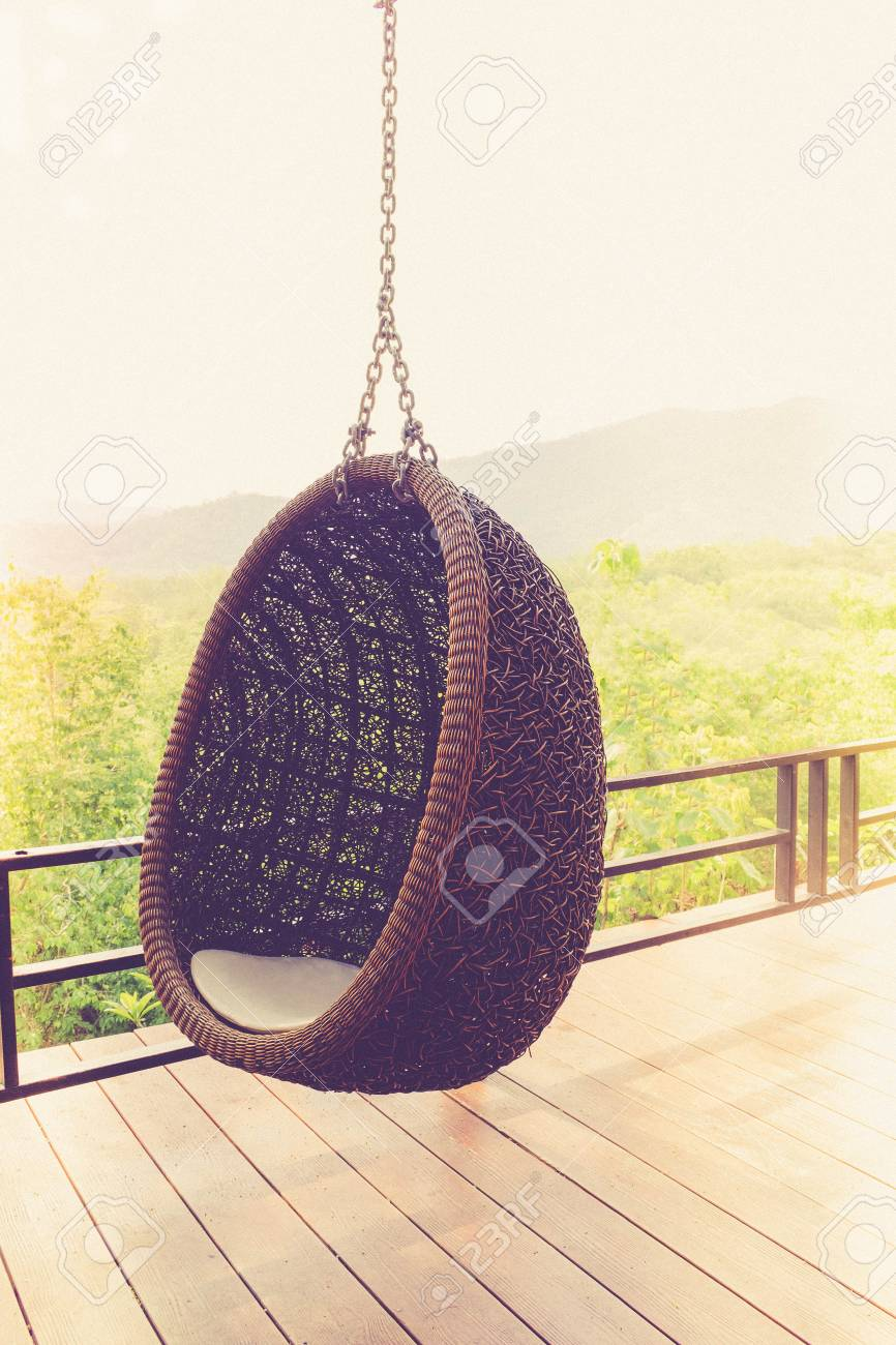 Hangstoel Rotan Wit.Rattan Lounge Hanging Chair With White Pillow At The Balcony