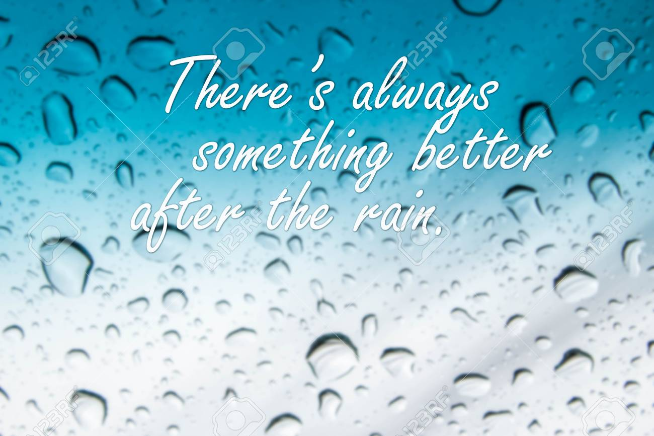 Rain Quotes On Abstract Blurred Rain Drop On Blue Mirror Stock Photo