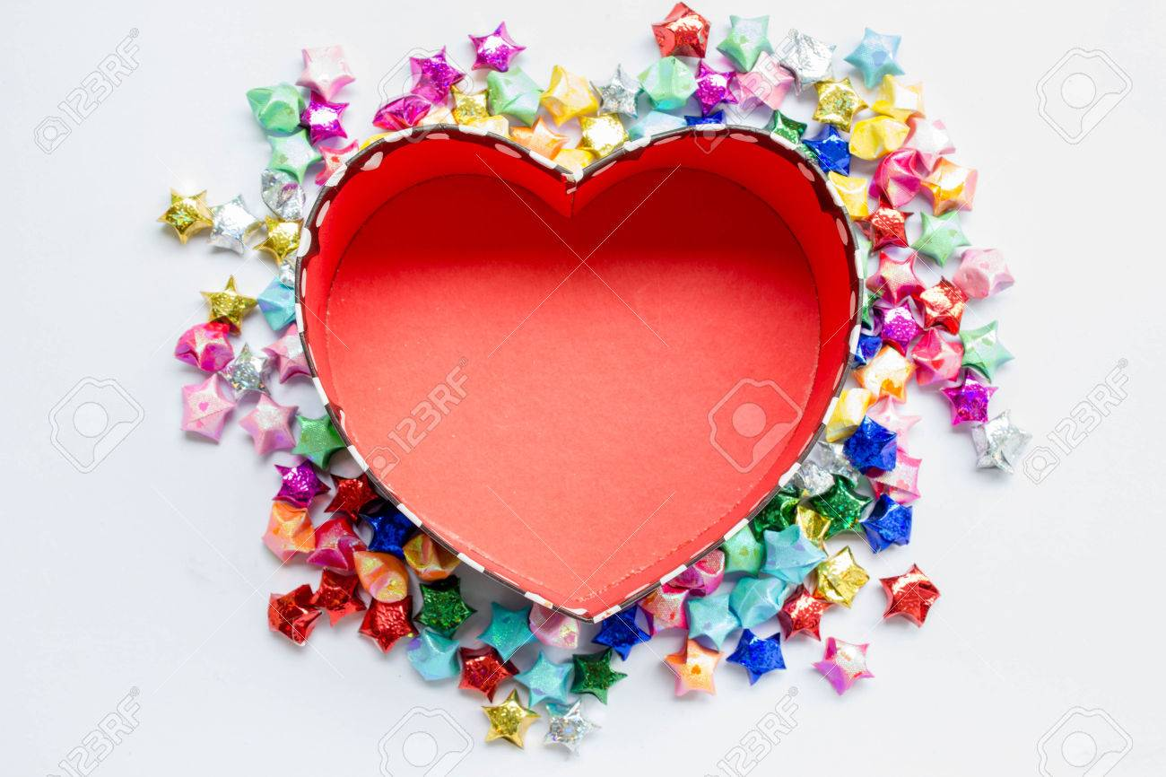 Colorful Folded Paper Star Or Origami Lucky Around The Heart Shaped Box To Use As