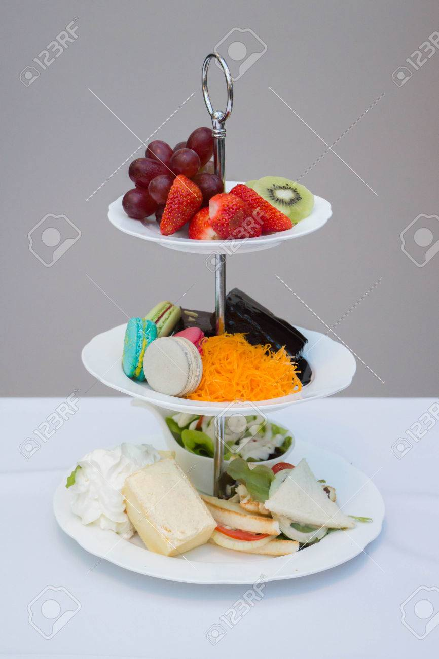 Cake And Fruit Displayed In Three Tier Serving Tray Stock Photo Picture And Royalty Free Image Image 74177310