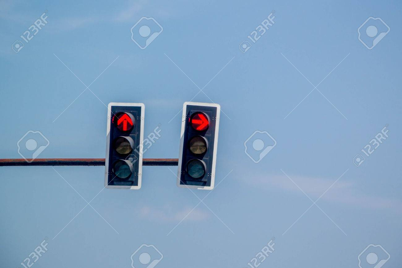 Awesome Red Arrow Traffic Light On Blue Sky Background Stock Photo   76478433 Design Ideas
