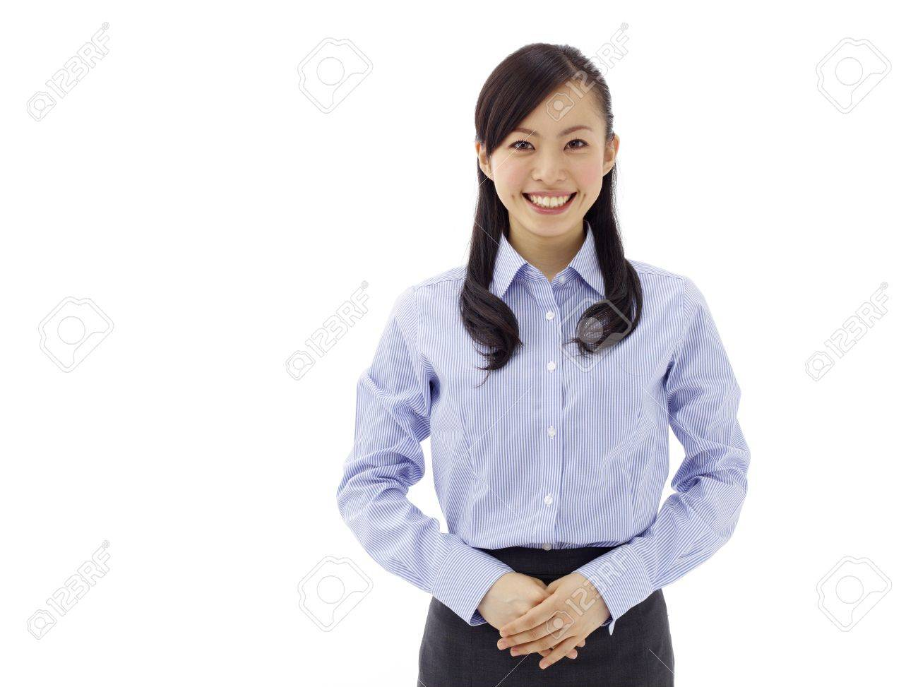 business woman smiling - isolated over a white background Stock Photo - 11677064