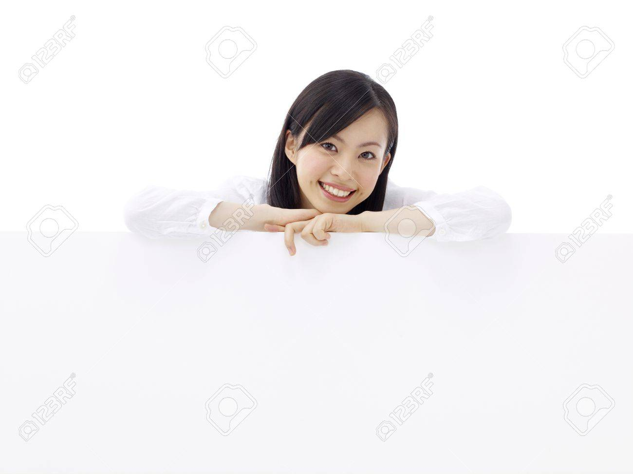 woman holding a blank billboard. Stock Photo - 11677080