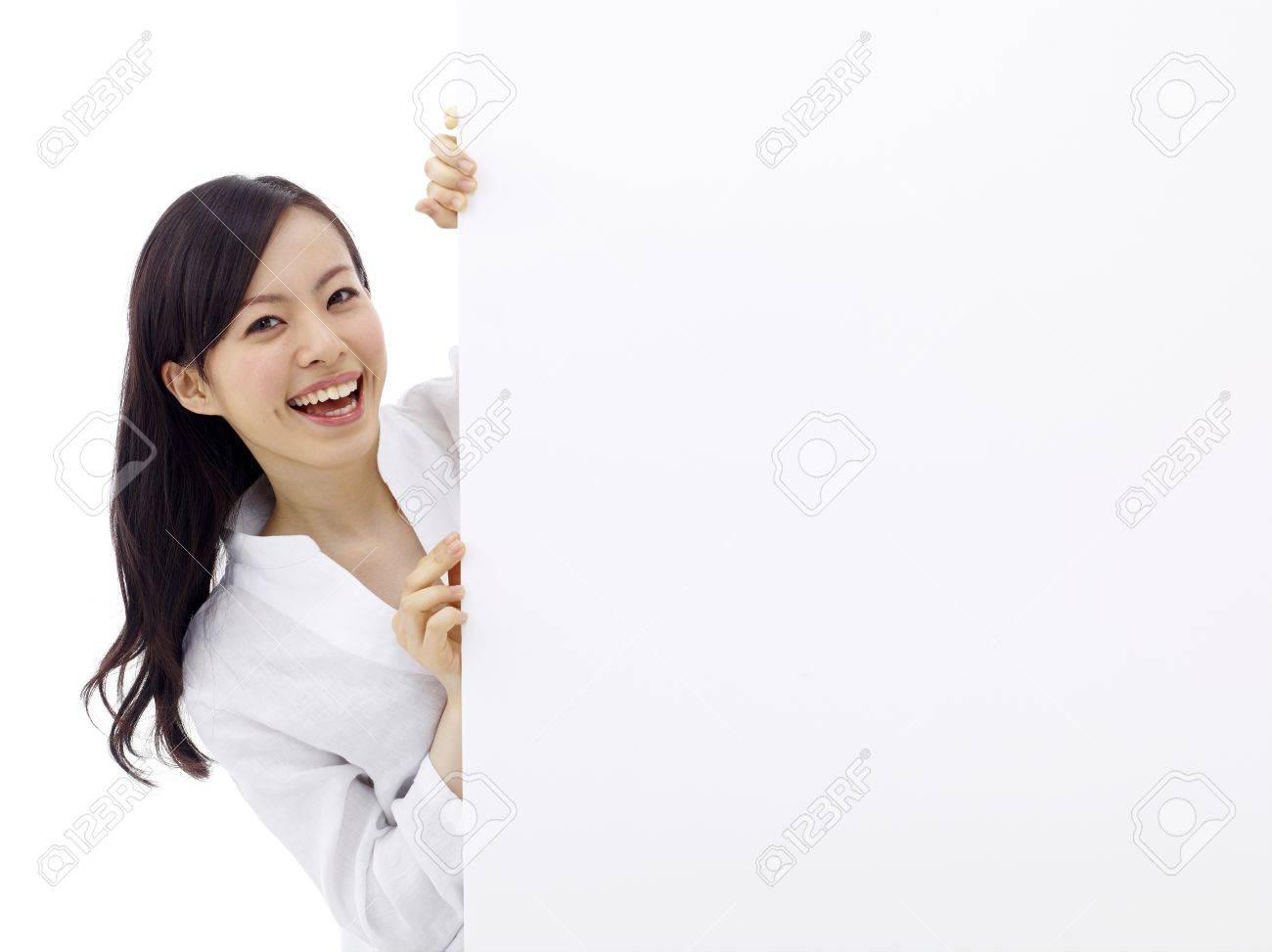 woman holding a blank billboard. Stock Photo - 11677091