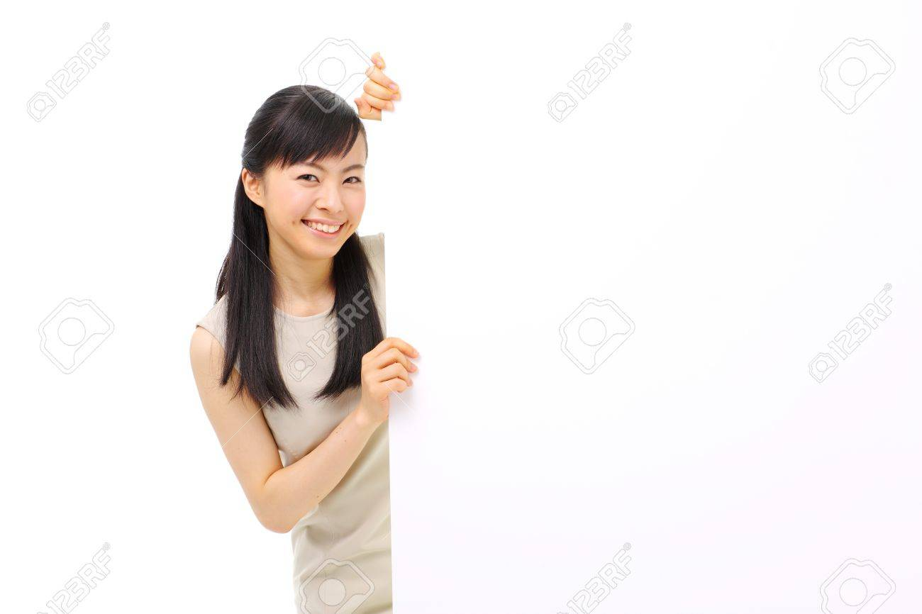 young business woman holding blank billboard, isolated on white background Stock Photo - 14344332
