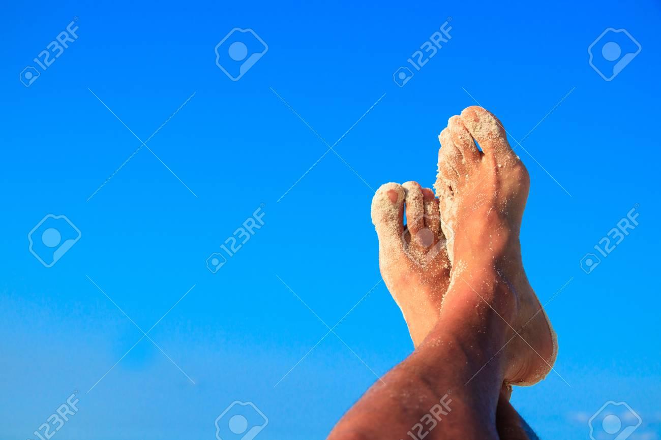timeless design 357a8 87120 Sandy men feet in the air Stock Photo - 103875191