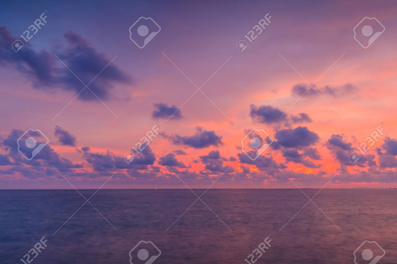 Colourful sunset for background. Dramatic sunset with twilight colour sky and clouds. - 103945903