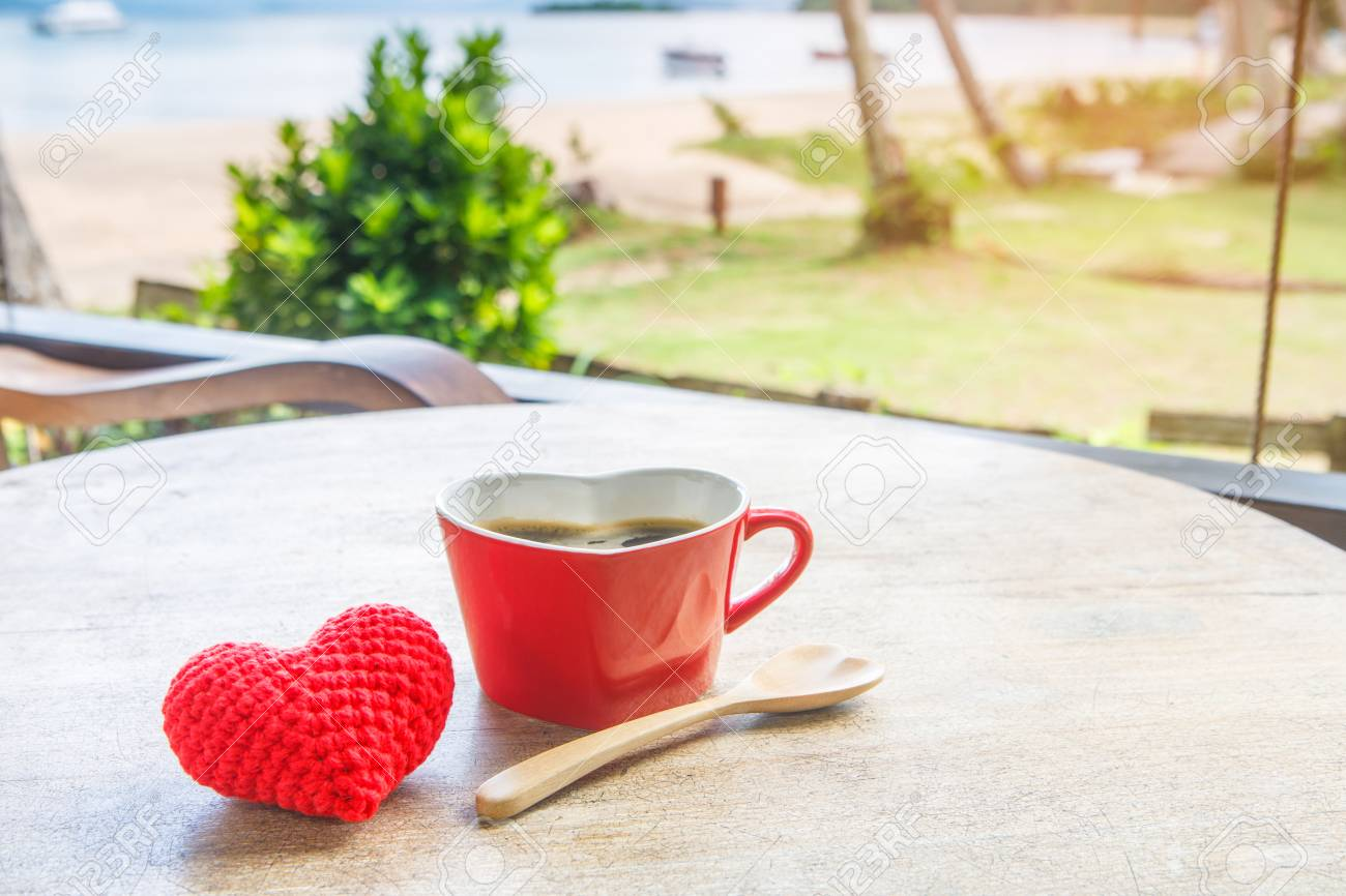 Coffee in the red cup and cake for breakfast in the garden on the beach. - 106342788