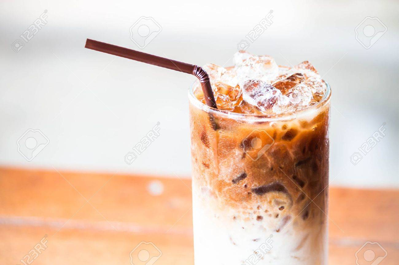 A glass of milk coffee with ice cubes Standard-Bild - 20459287