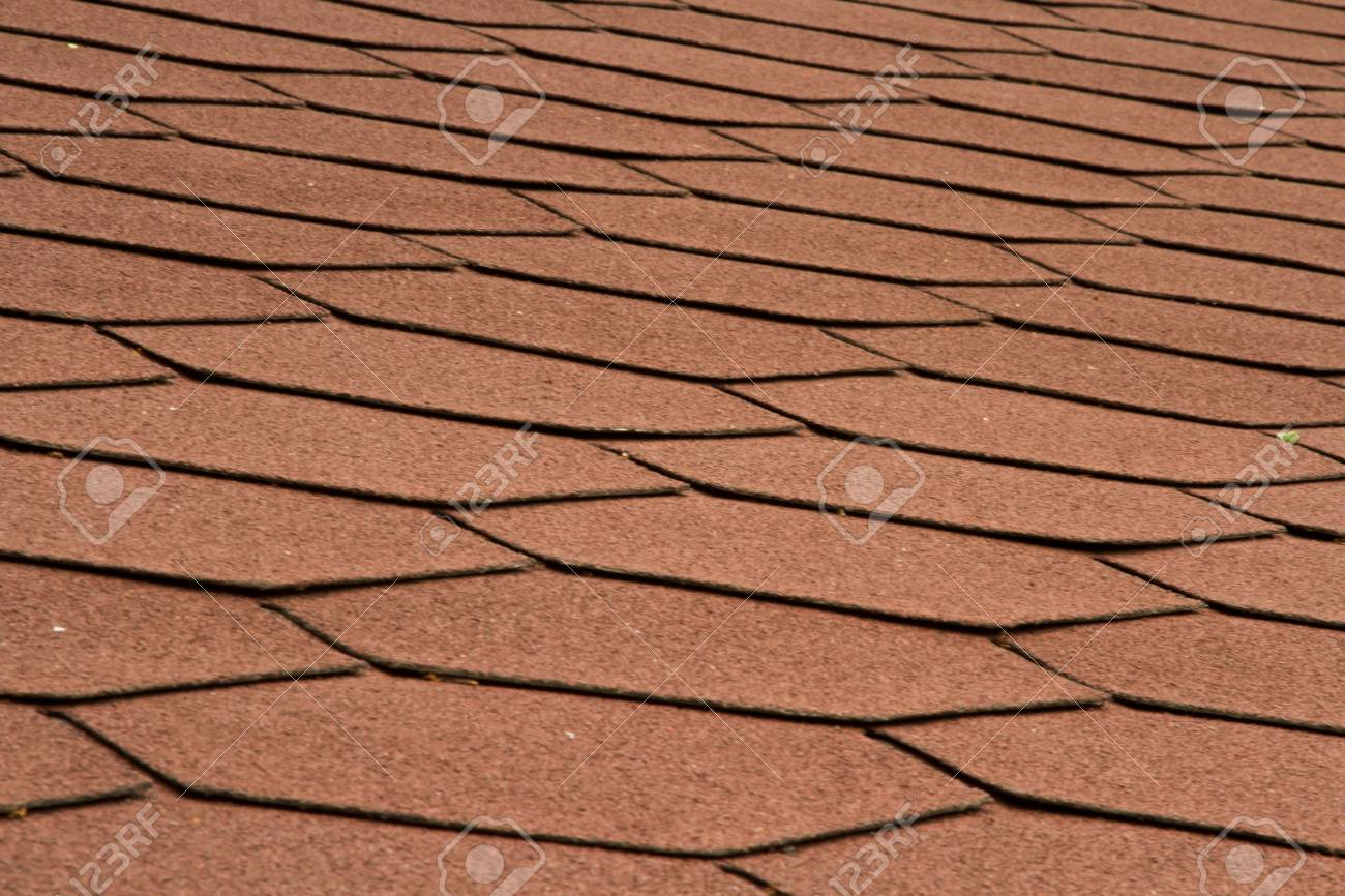 Texture di mattonelle rosse tetto del nuovo edificio foto royalty