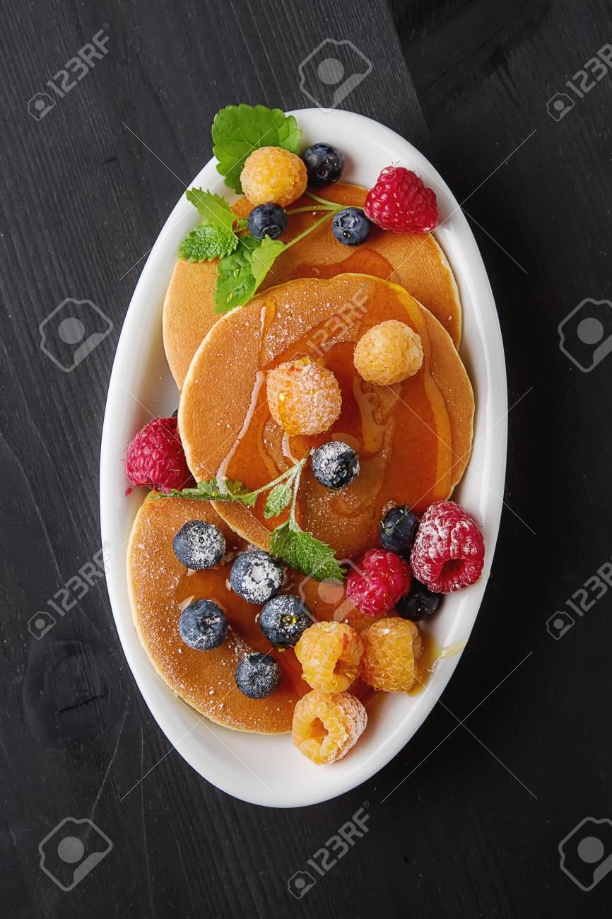English fresh homemade pancakes with raspberries, blueberries,