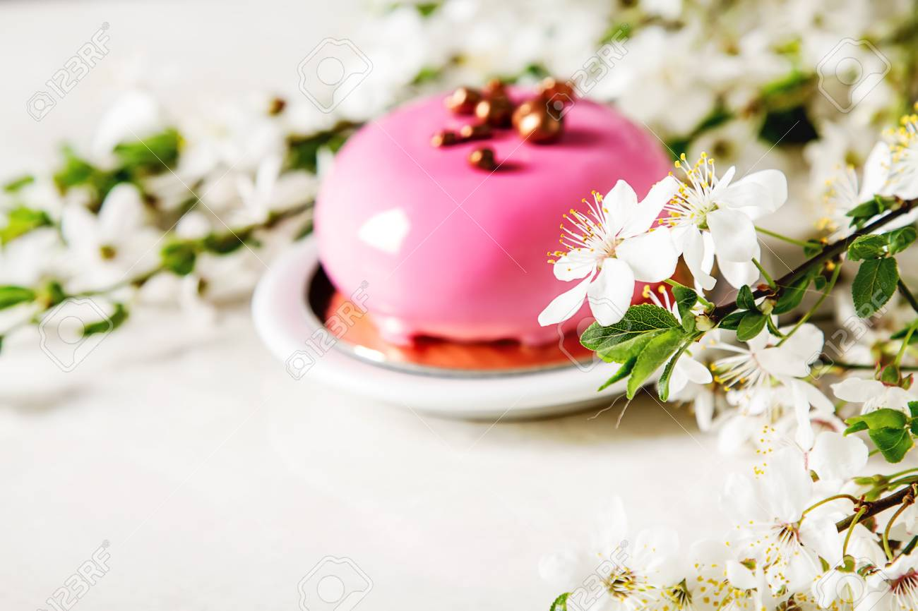 Fashionable Mousse Cake With A Mirror Glaze Decorated With Spring