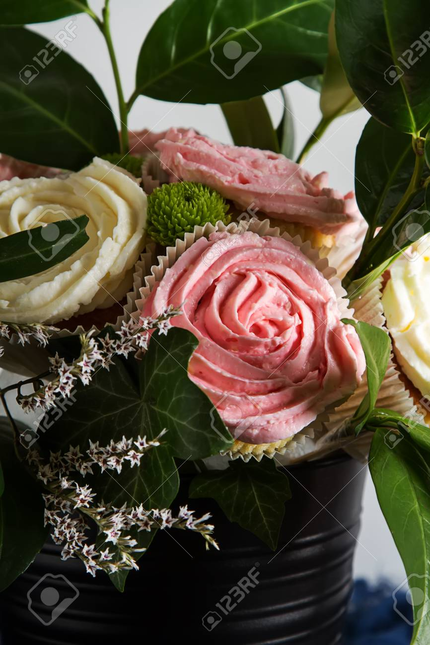 Bouquet Of Cupcake And Green Leaves In A Black Flowerpot Dark