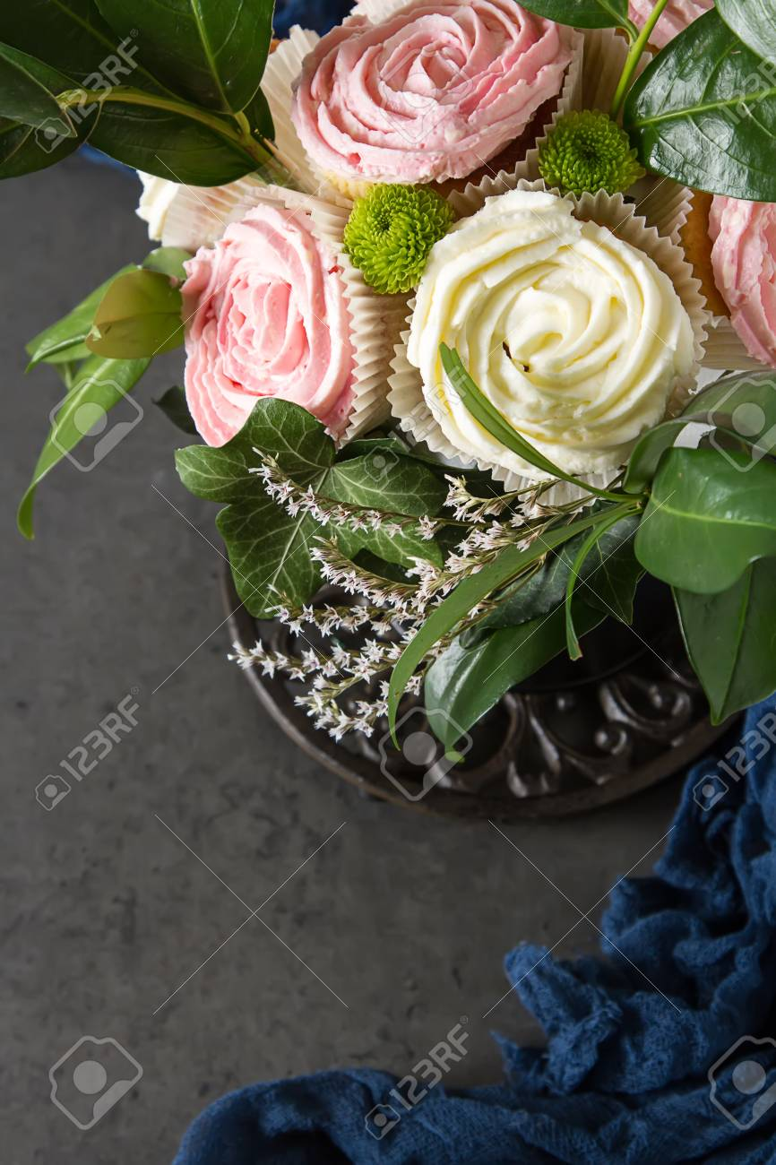 Bouquet Of Cupcake And Green Leaves In A Black Flowerpot. Dark ...