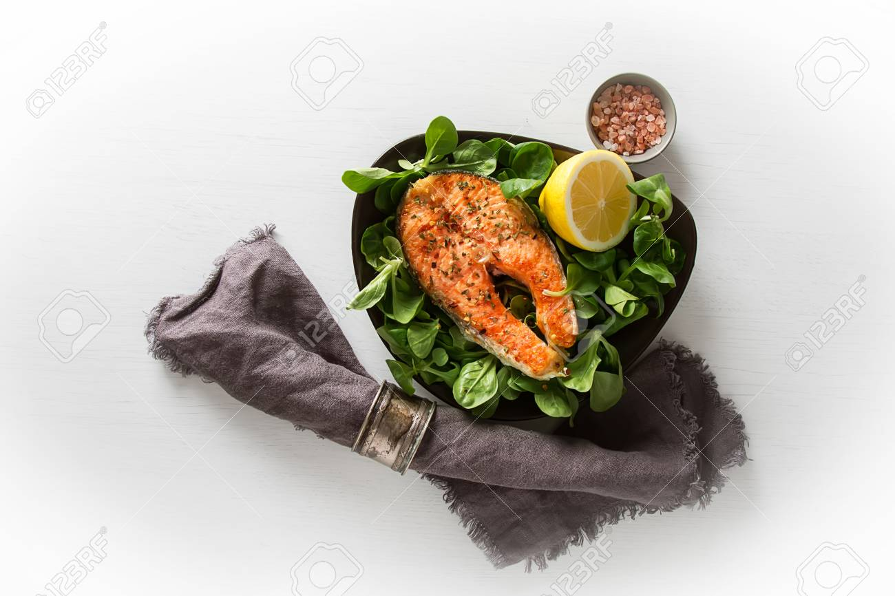 Grilled Salmon Steak With Lemon Spices And Green Salad Cooked