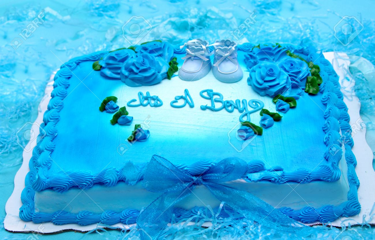 Bright Blue Sheet Cake Is Decorated With Roses And Scalloped Edges Baby Booties In