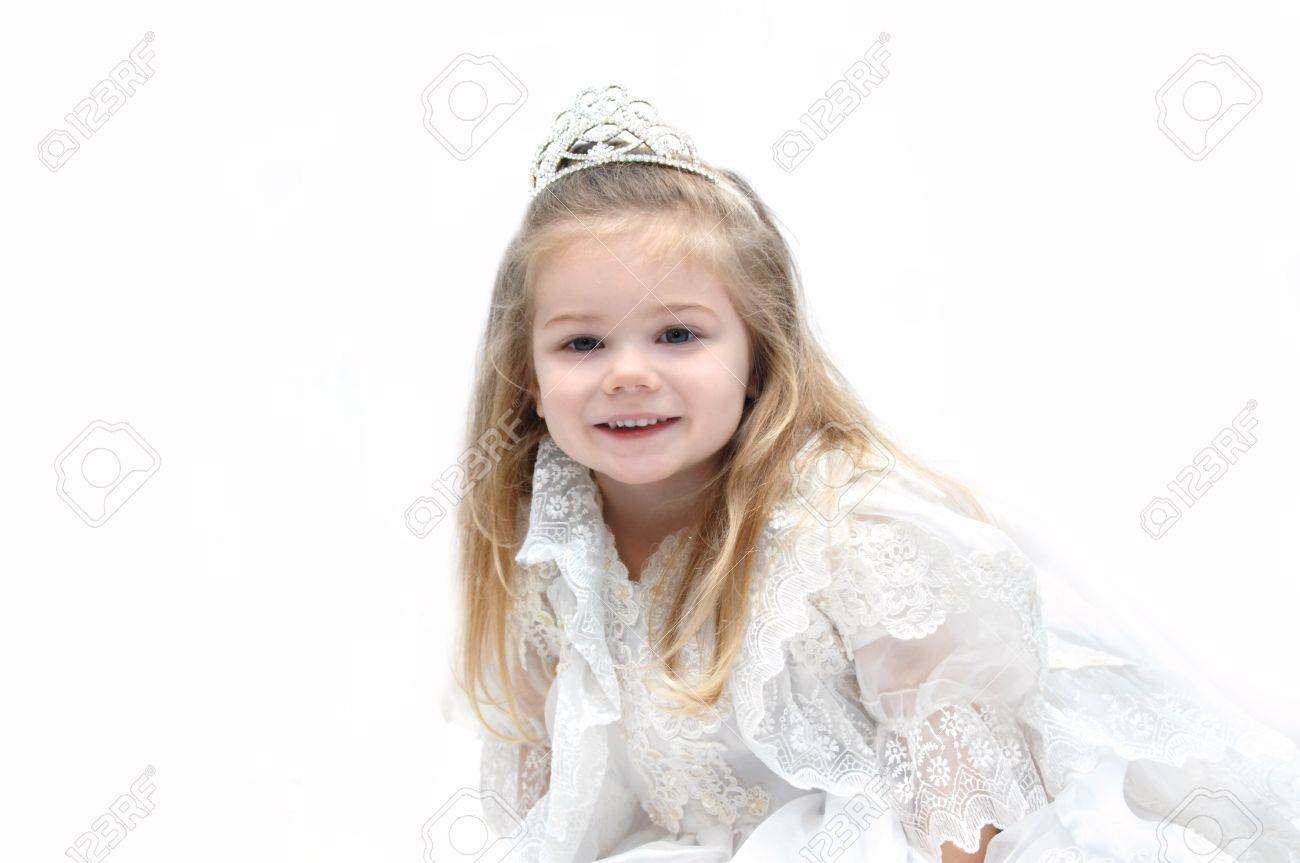Little Girl Wears An Elegant Wedding Dress And Crown. She Is.. Stock ...