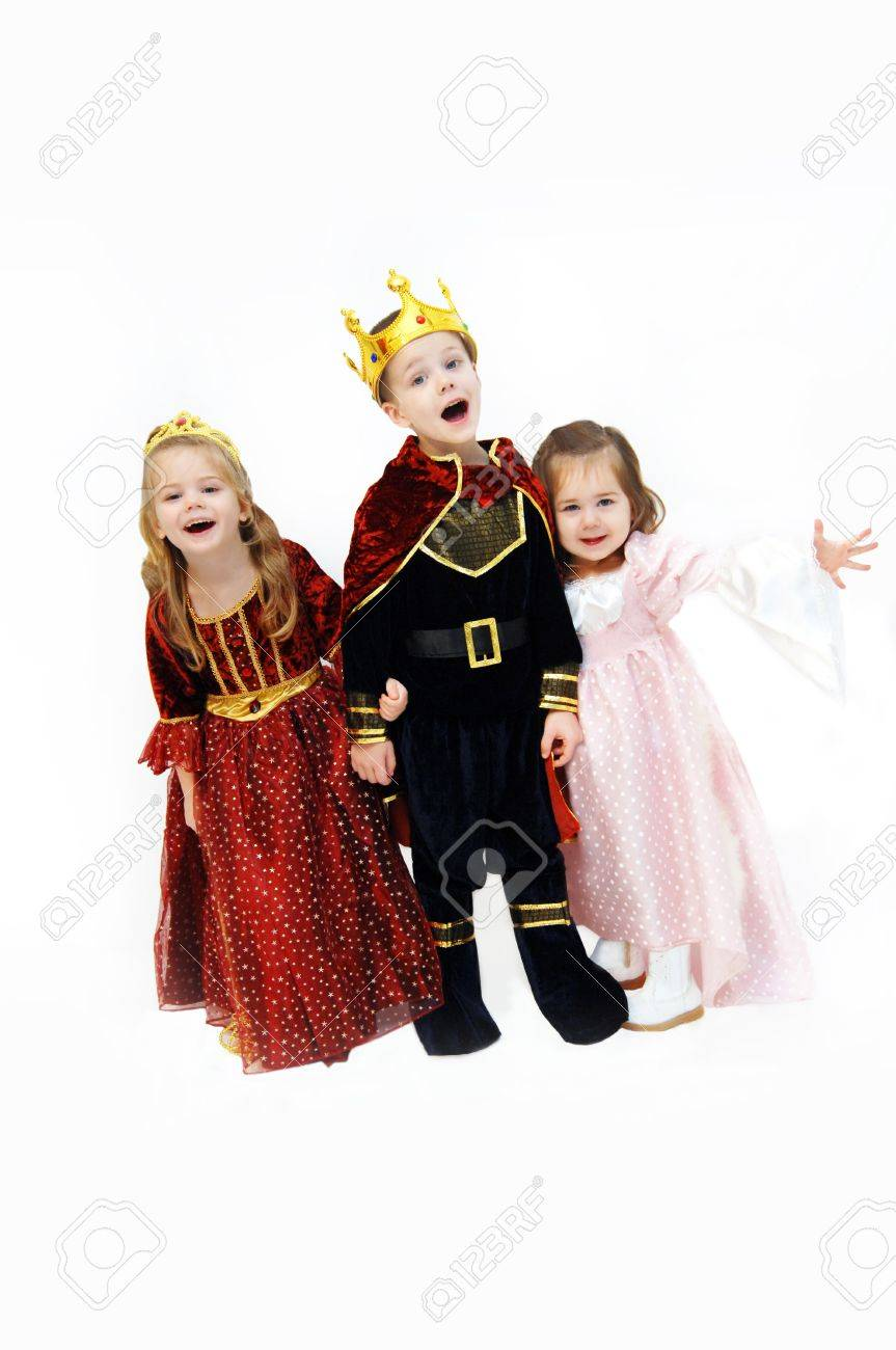 King, queen and princess are laughing and talking as they pose in their Halloween costumes. Children are wearing crowns, gowns and royal cape. - 14863805