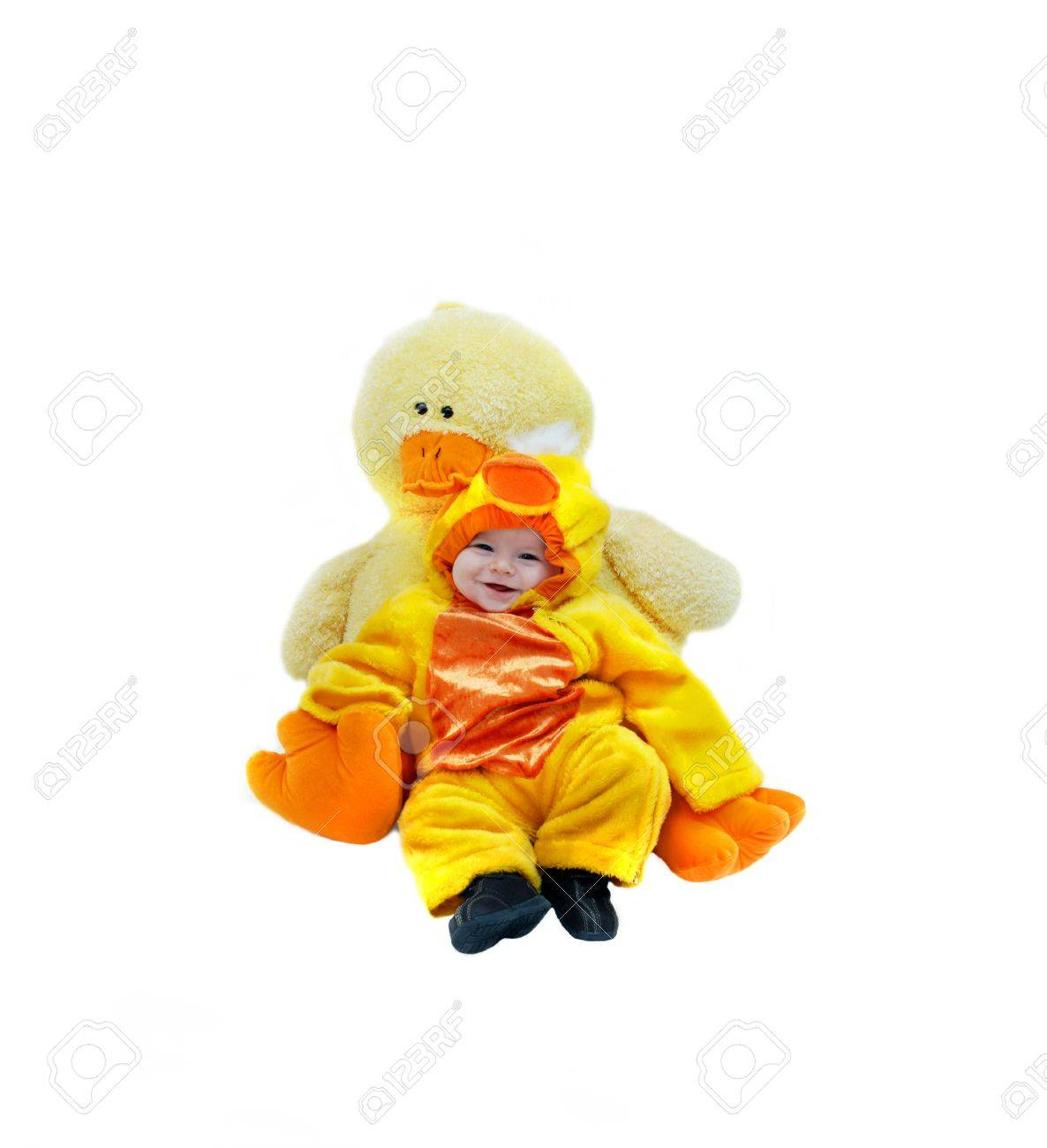 Baby dressed in baby duckling costume, cuddles with its mother
