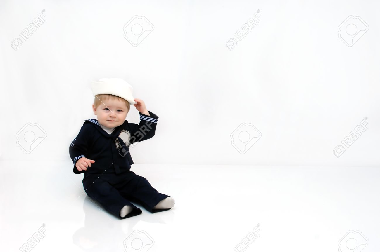 Baby boy is wearing a navy sailor costume. He is smiling and touching his  sc 1 st  123RF.com & Baby Boy Is Wearing A Navy Sailor Costume. He Is Smiling And ...