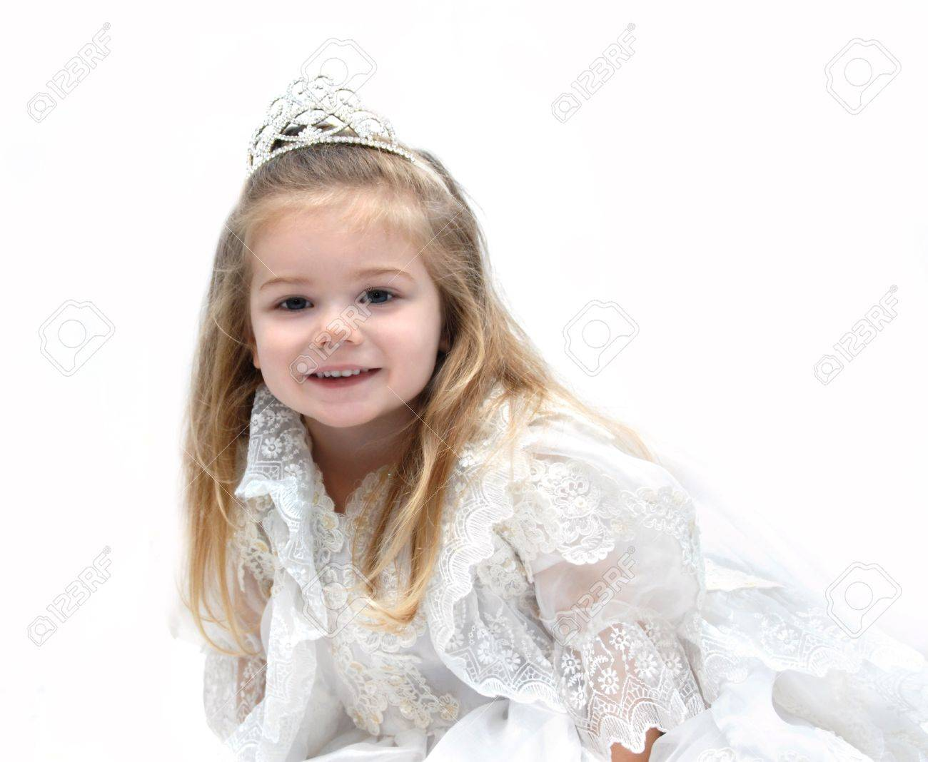 Little Girl Wears An Elegant Wedding Dress And Crown She Is.. Stock ...