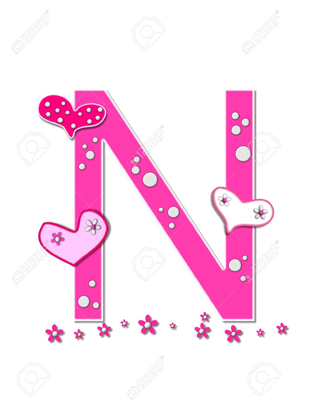 stock photo the letter n in the alphabet set heartfull is pink outlined with white polka dots and hearts decorate letter with a line of pink flowers at