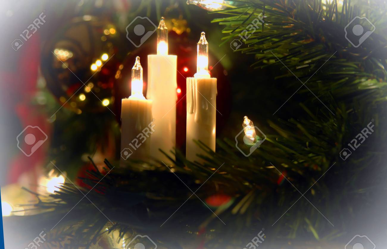 Three Electric Candles Spread A Warm Glow On A Christmas Tree