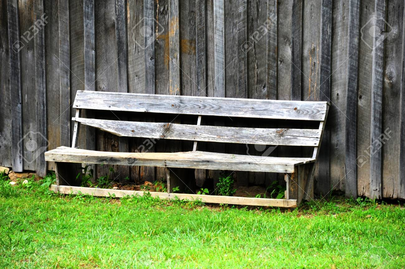 Hand Made Rustic Wooden Bench Sits Exposed To The Weather In Northern  Arkansas. Stock