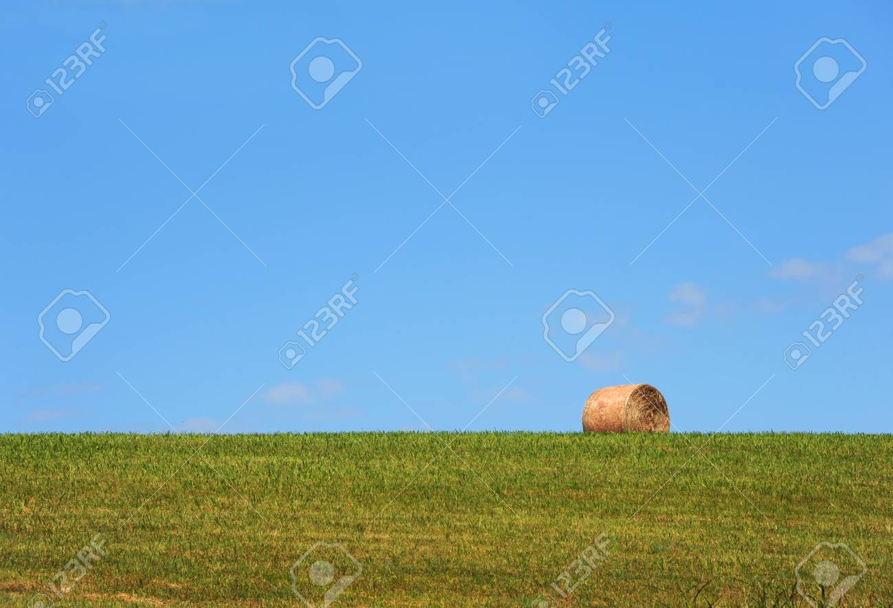Background Image Shows A Single Roll Of Hay Sitting At The Top