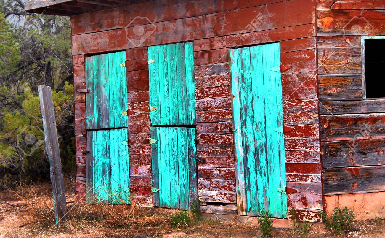 Triple Barn Doors Painted Turquoise Form The Front Of This Rustic