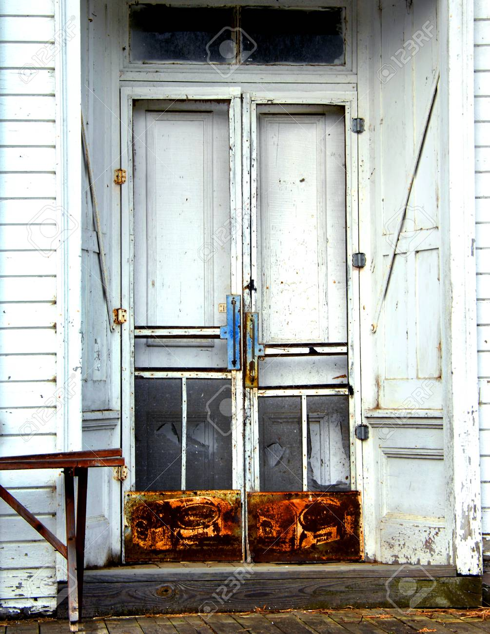 Old Wooden Country Store Has Double Doors With Screen Protectors