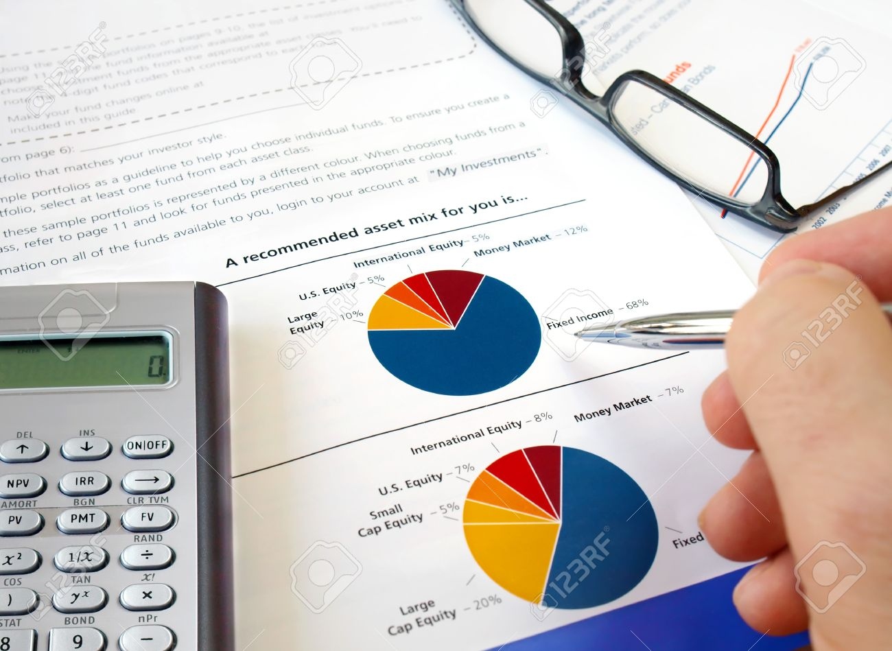 Male hand with pen on the pie investment chart with calculator male hand with pen on the pie investment chart with calculator and glasses stock photo nvjuhfo Image collections