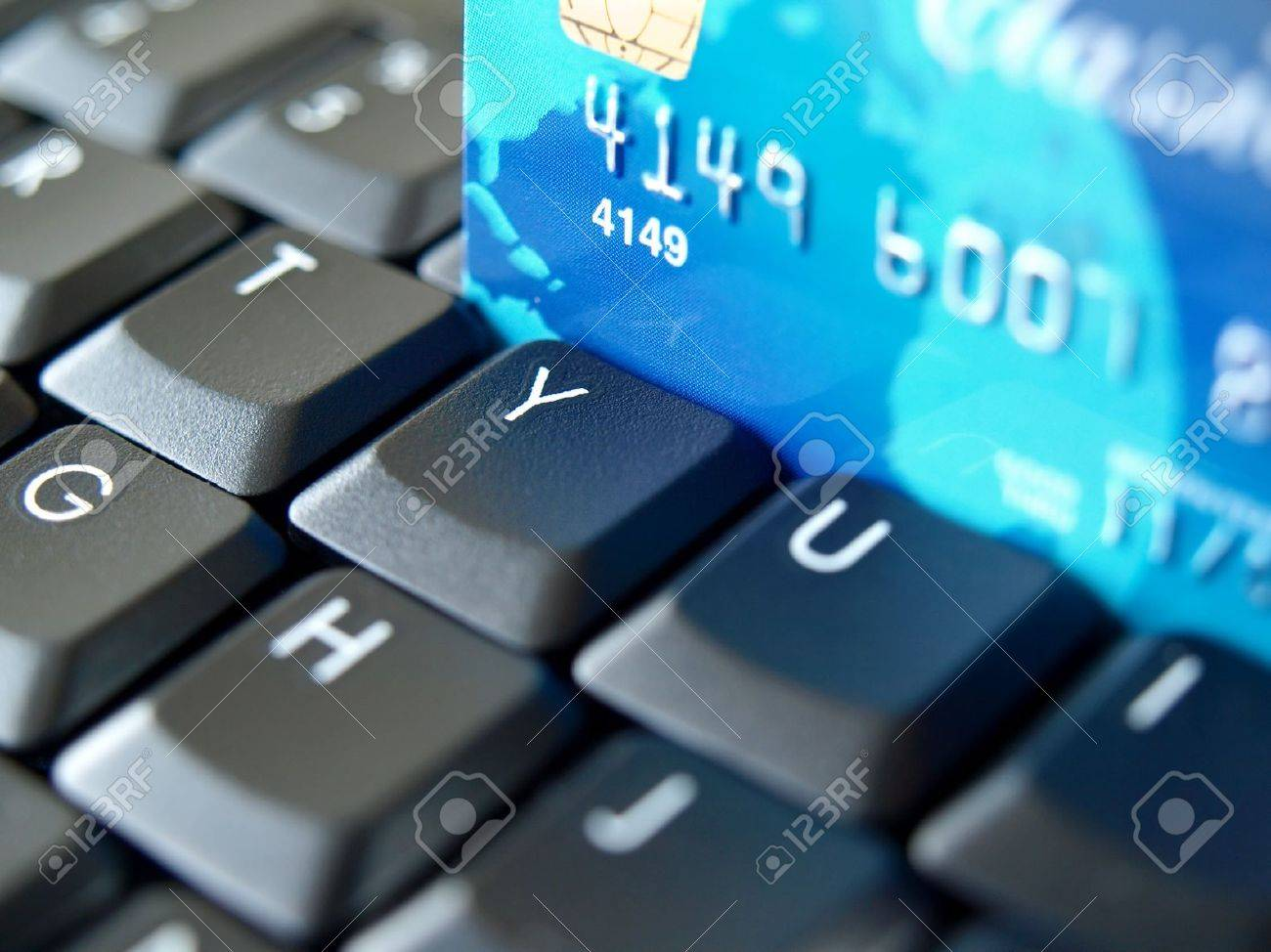 Credit card on computer keyboard. Stock Photo - 9293890