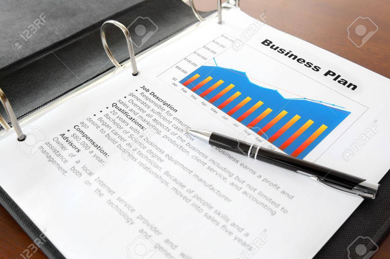 business plan with pen in the binder on the table stock photo