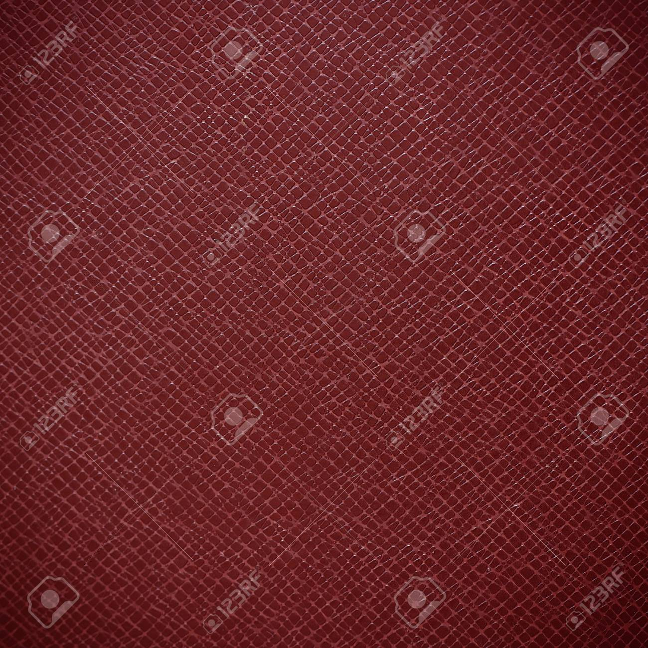 Red leather texture closeup Standard-Bild - 42724577