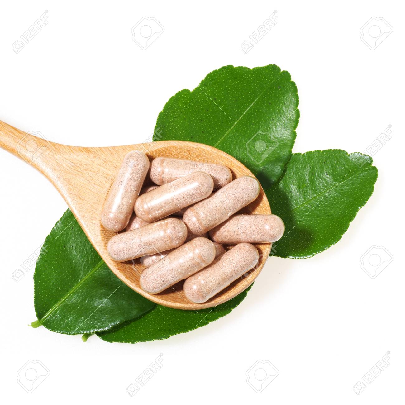 Herbal medicine capsules with leaf of Herb isolated on white background Standard-Bild - 54149964