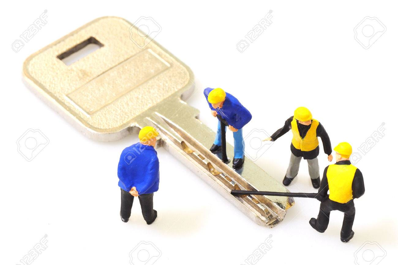 Group of locksmith workers are making the key isolated on white background Standard-Bild - 62677577