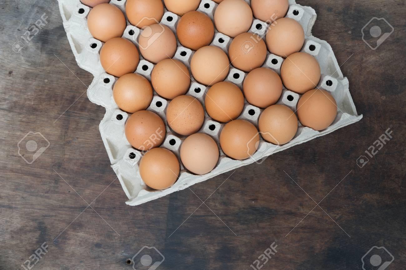 Chicken egg on wooden background with copy space Standard-Bild - 81259712