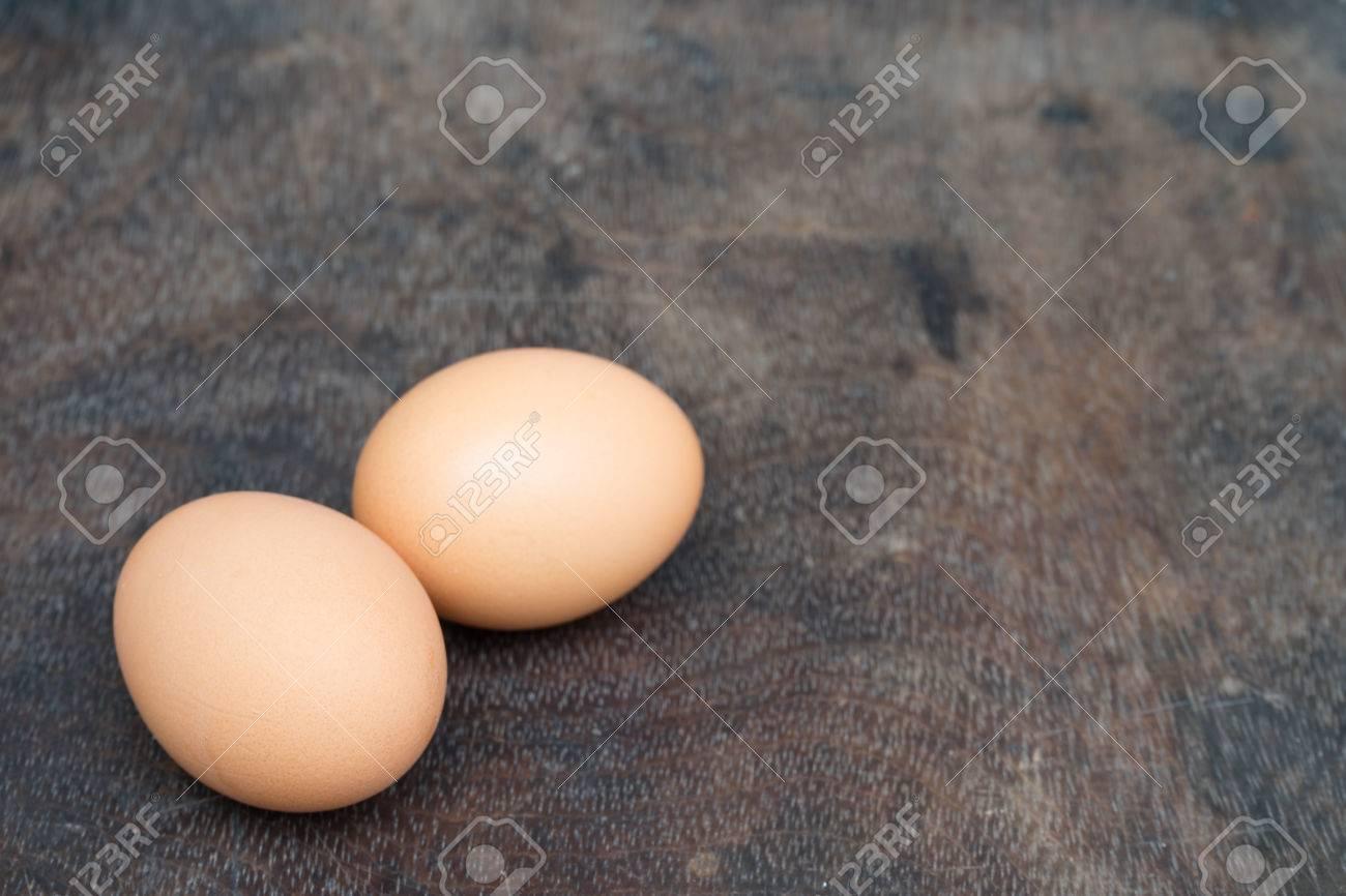 Chicken egg on wooden background with copy space Standard-Bild - 81259710