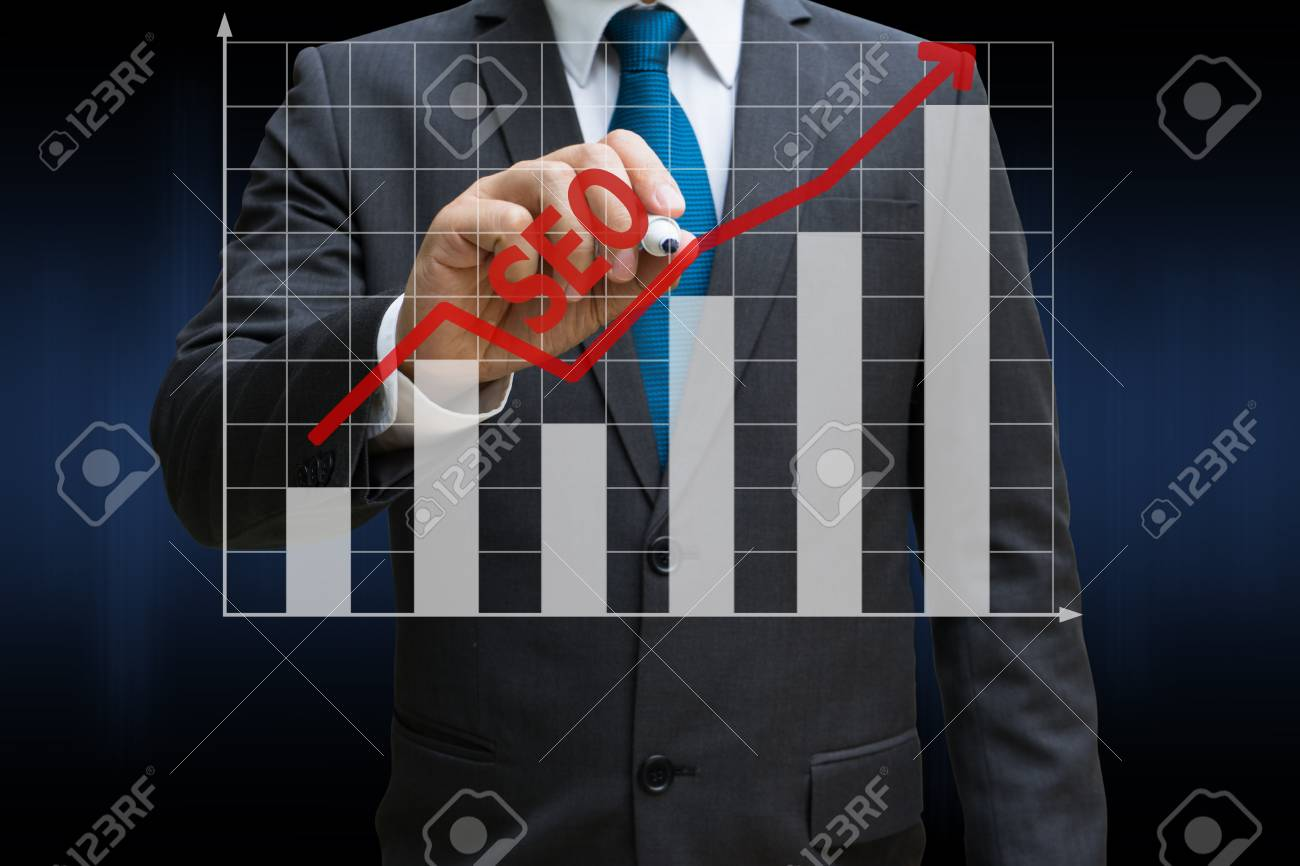 business man drawing the SEO bar charts showing growing revenue on touch screen Standard-Bild - 81523411
