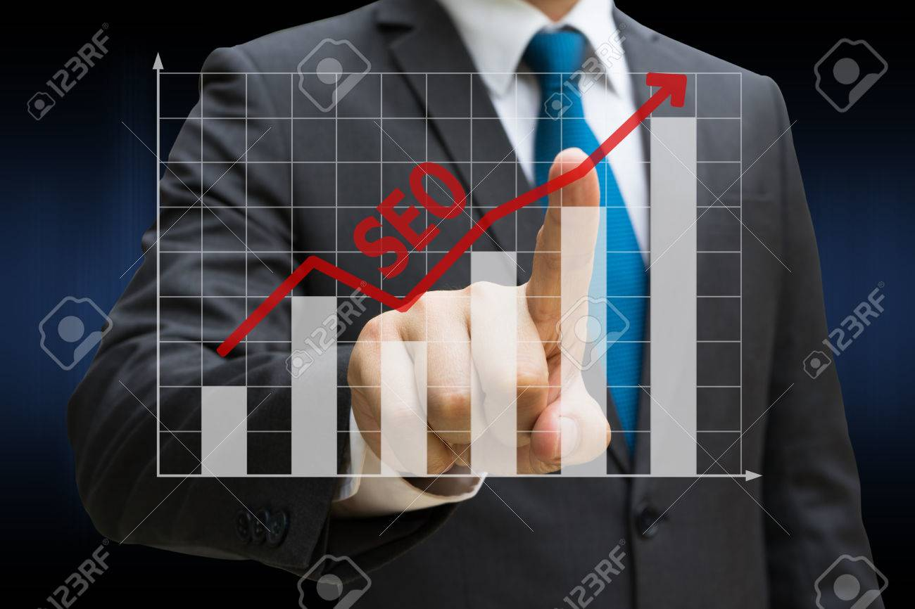 Businessman hand touching the SEO bar charts showing growing revenue on touch screen Standard-Bild - 81561614