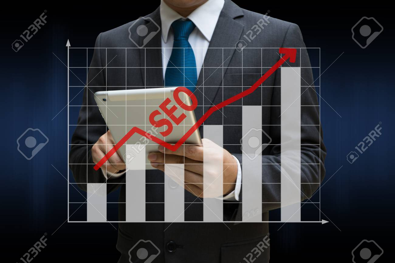 Business Man touching modern tablet with the SEO bar charts showing growing revenue on touch screen Standard-Bild - 81523372
