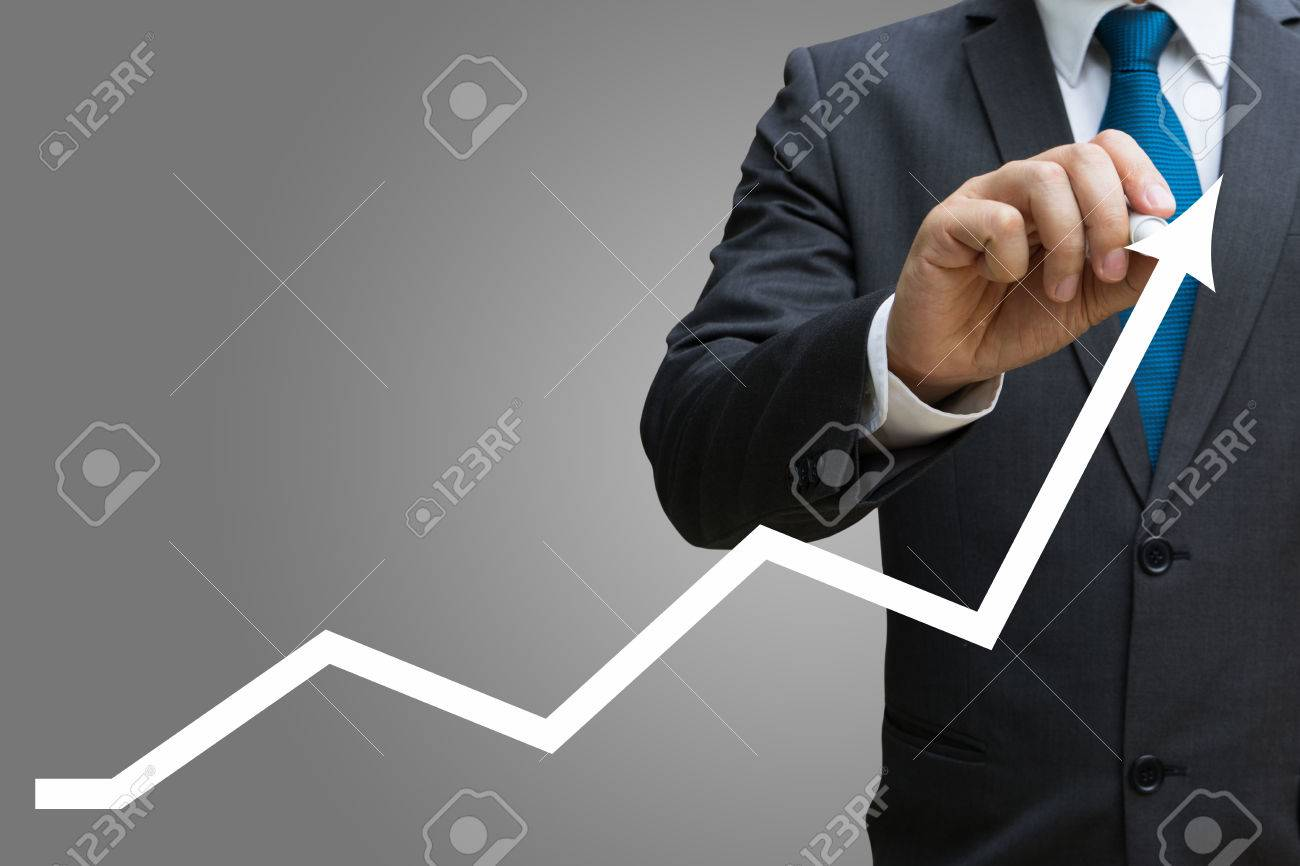businessman drawing the financial line charts showing growing revenue on touch screen Standard-Bild - 82426438