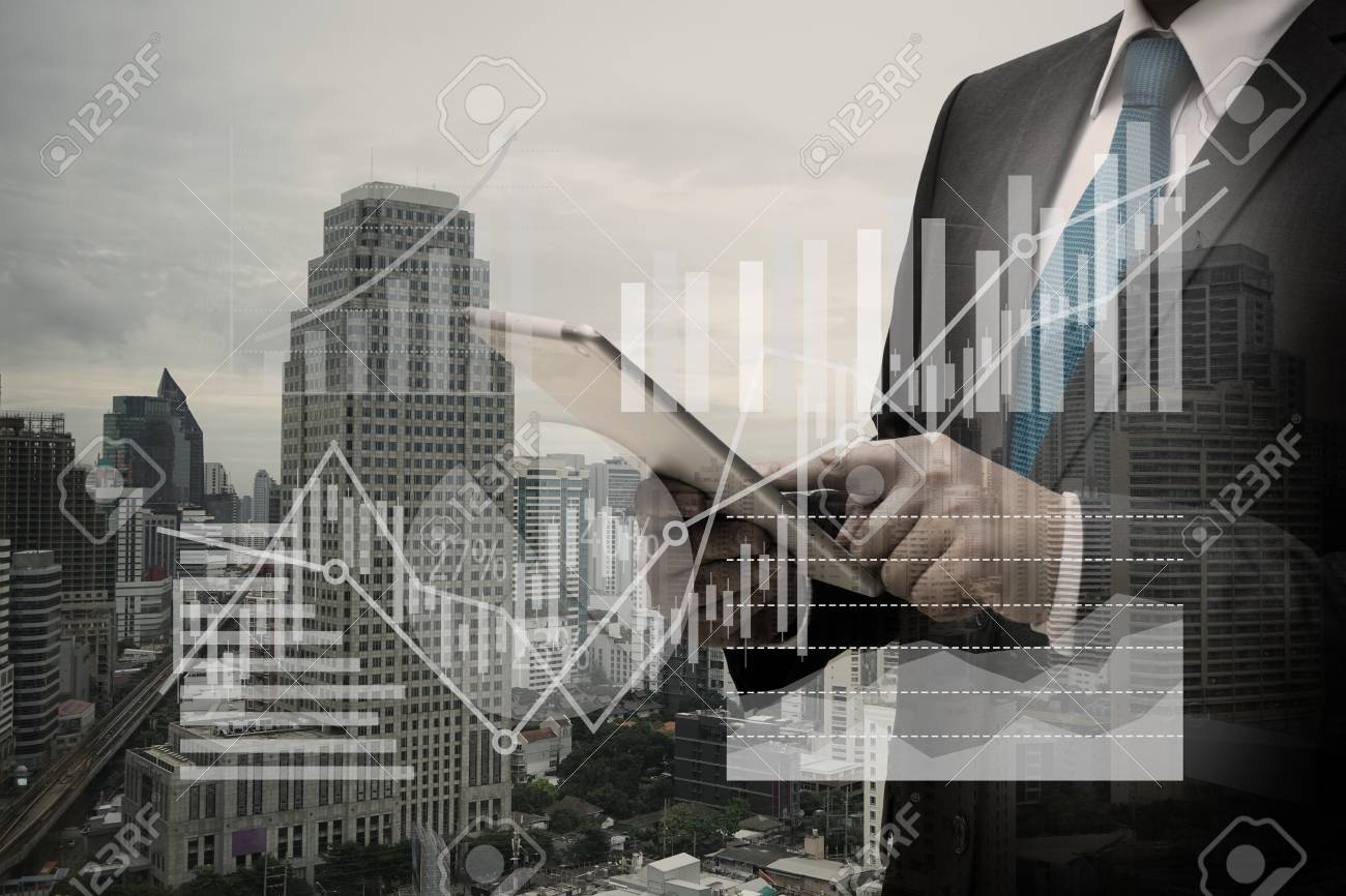 Double exposure of Businessman Using Digital Tablet with the virtual panel of pie chart and other chart , business concept Standard-Bild - 84764911