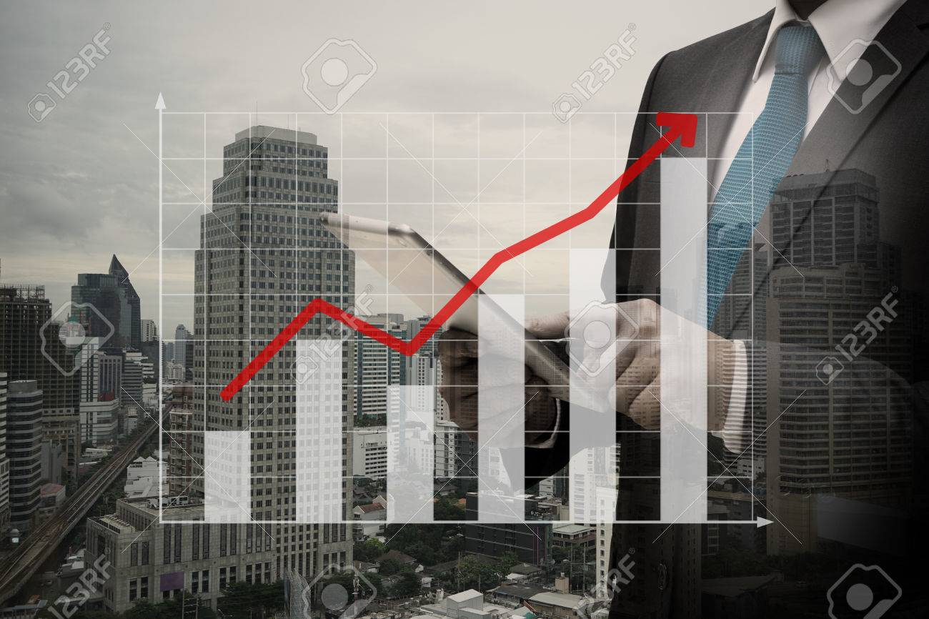 Double exposure of Businessman Using Digital Tablet with the virtual panel of bar chart , business concept Standard-Bild - 84499841