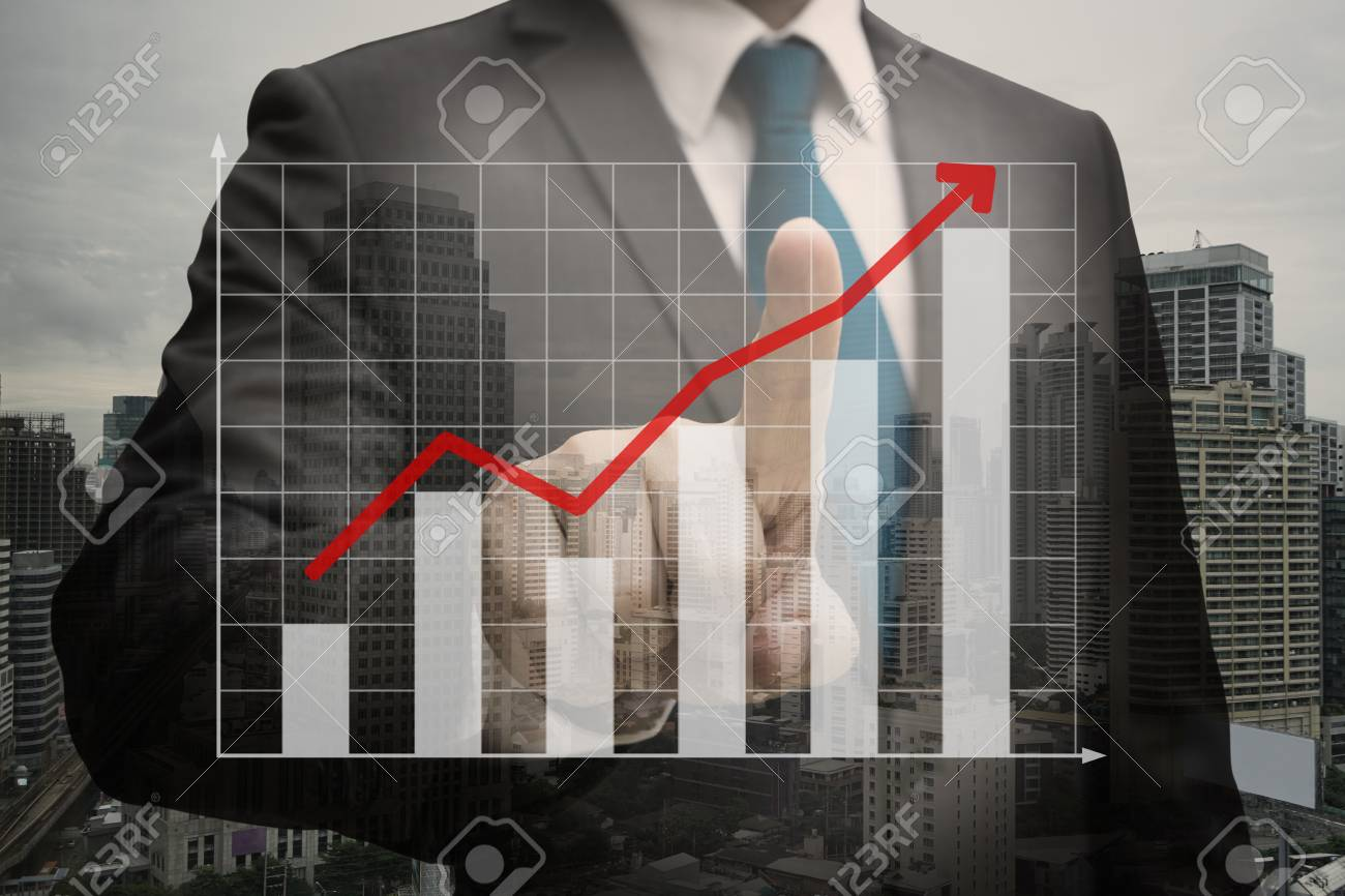 Double exposure of Businessman hand touching the virtual panel of bar chart , business concept Standard-Bild - 84547836